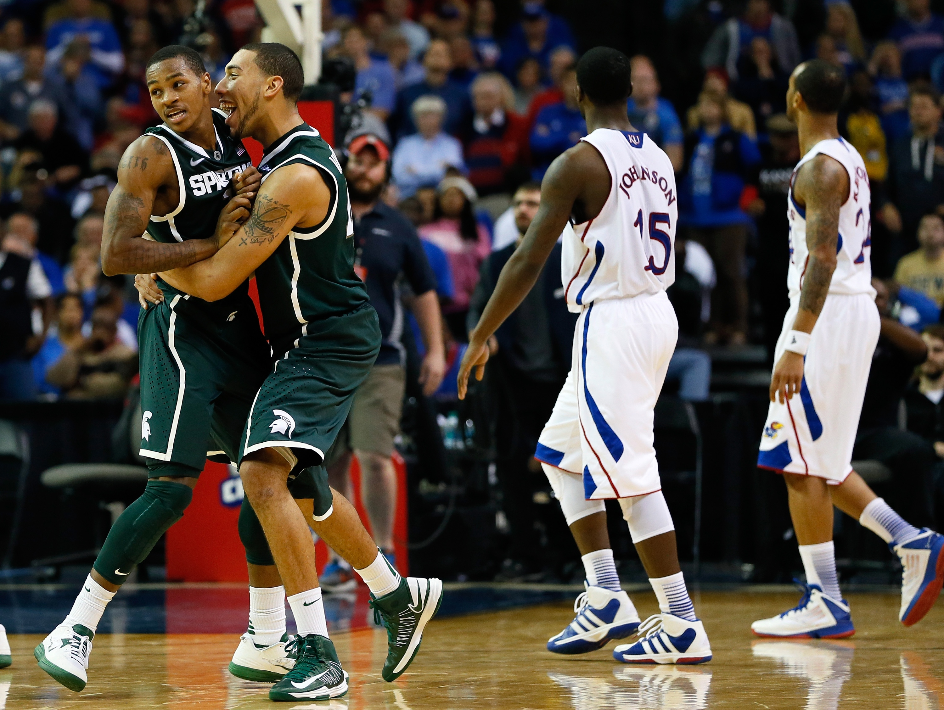 Keith Appling celebrates with Denzel Valentine in MSU's win over Kansas. (Getty)
