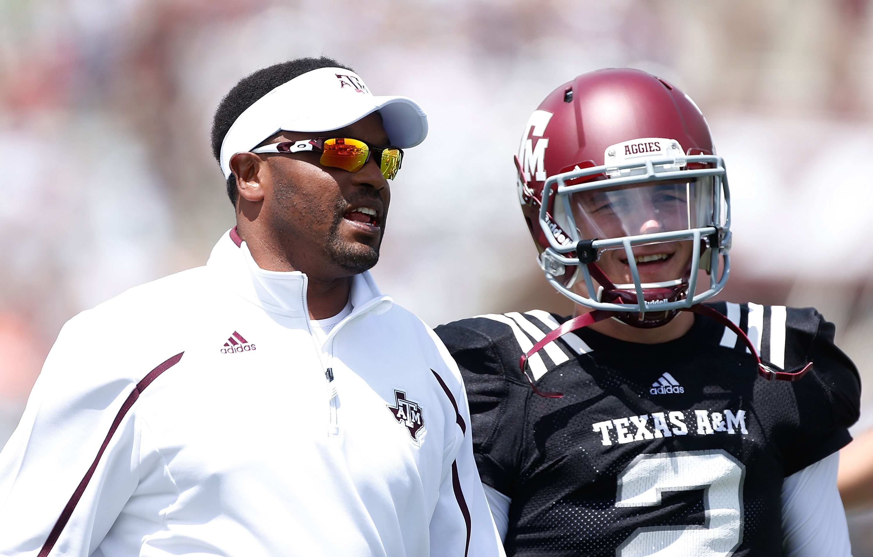 Kevin Sumlin talks with Johnny Manziel before the Maroon & White spring football game. (Getty)
