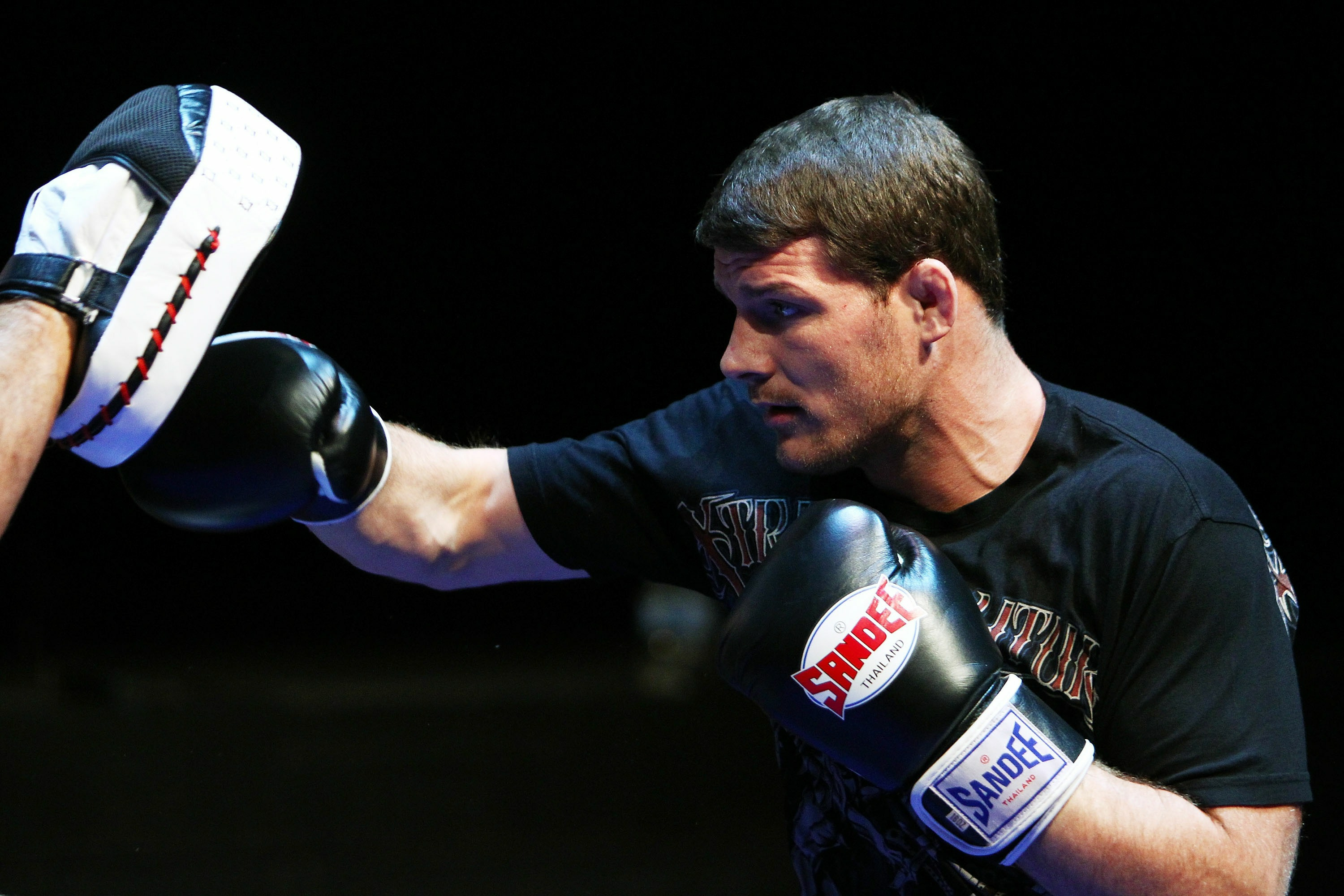 Michael Bisping does some glove work in preparation for a fight. (Getty)