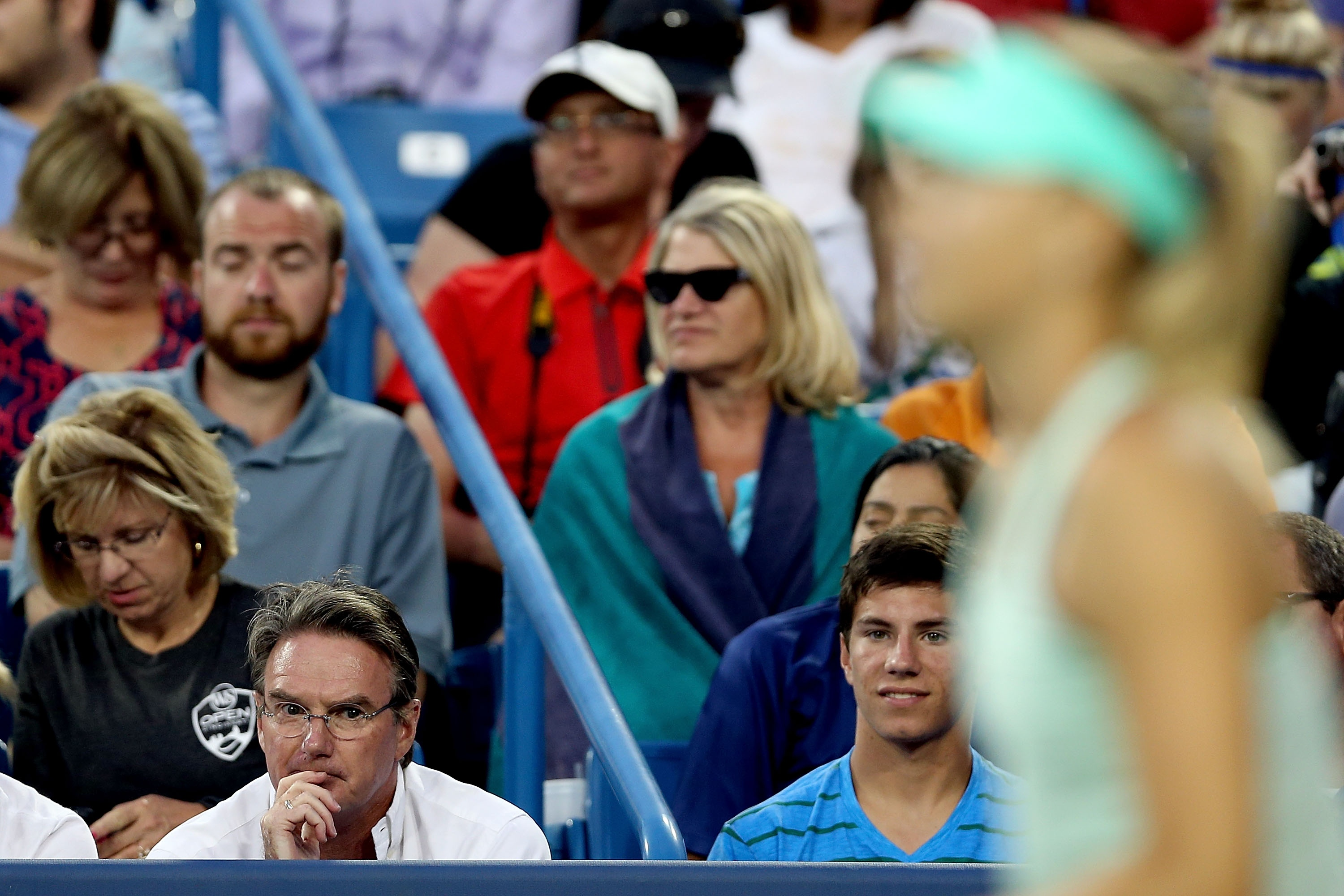 Jimmy Connors watches Maria Sharapova as she plays Sloane Stephens. (Getty Images)