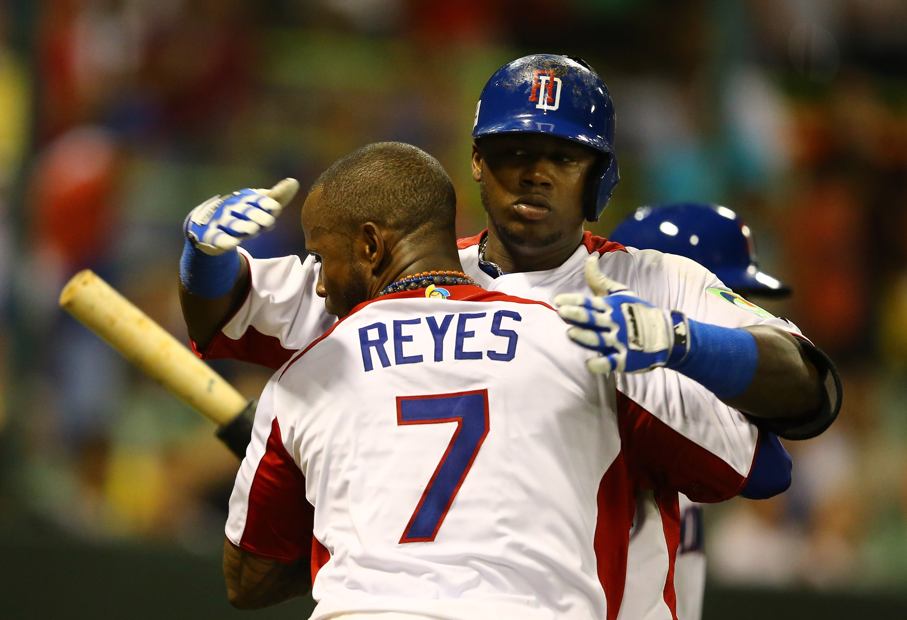 Hanley Ramirez gets a warm welcome from Jose Reyes after hitting a HR on Thursday. (Getty Images)