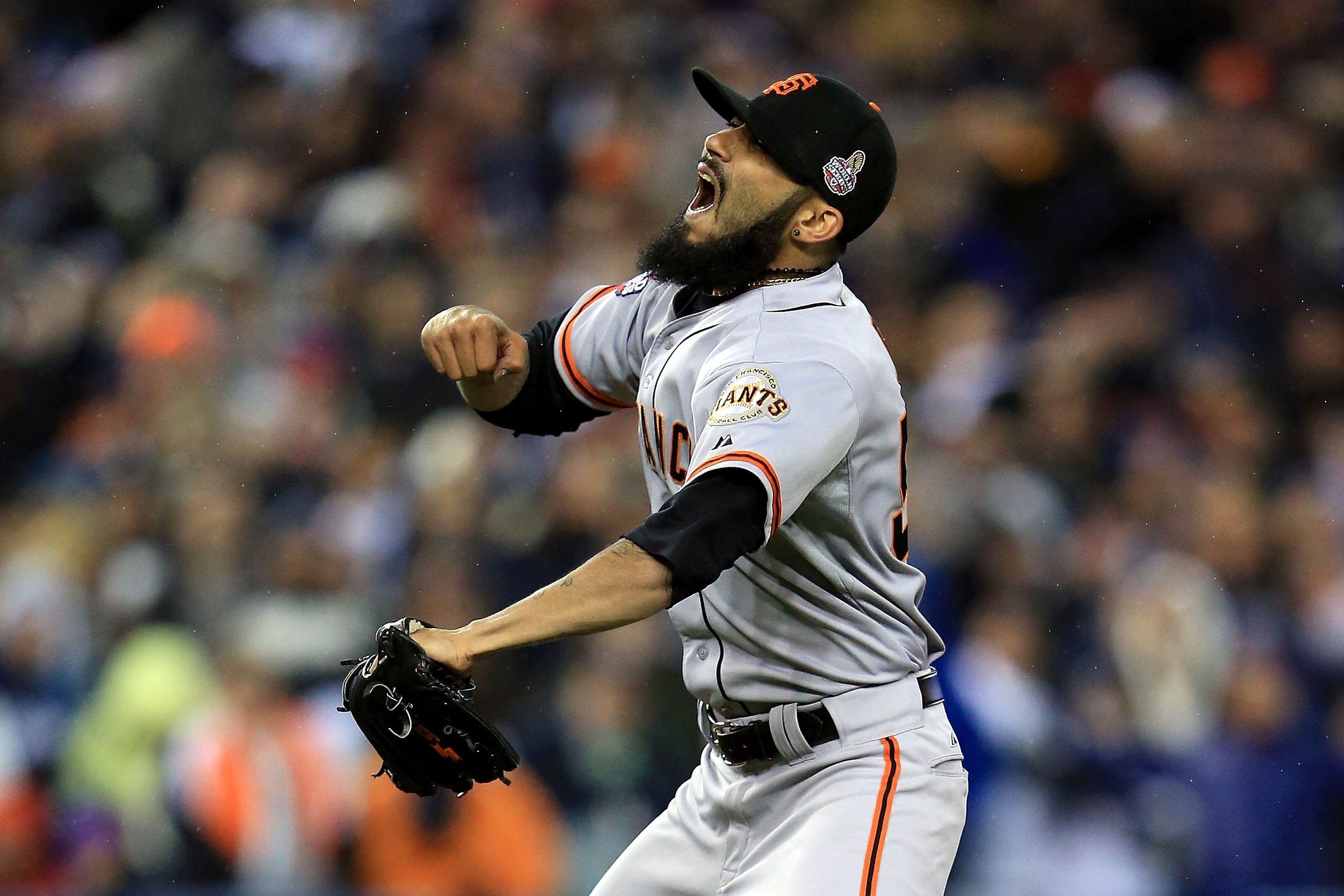 Sergio Romo reacts after striking out Miguel Cabrera in the 10th inning of Game 4. (Getty)