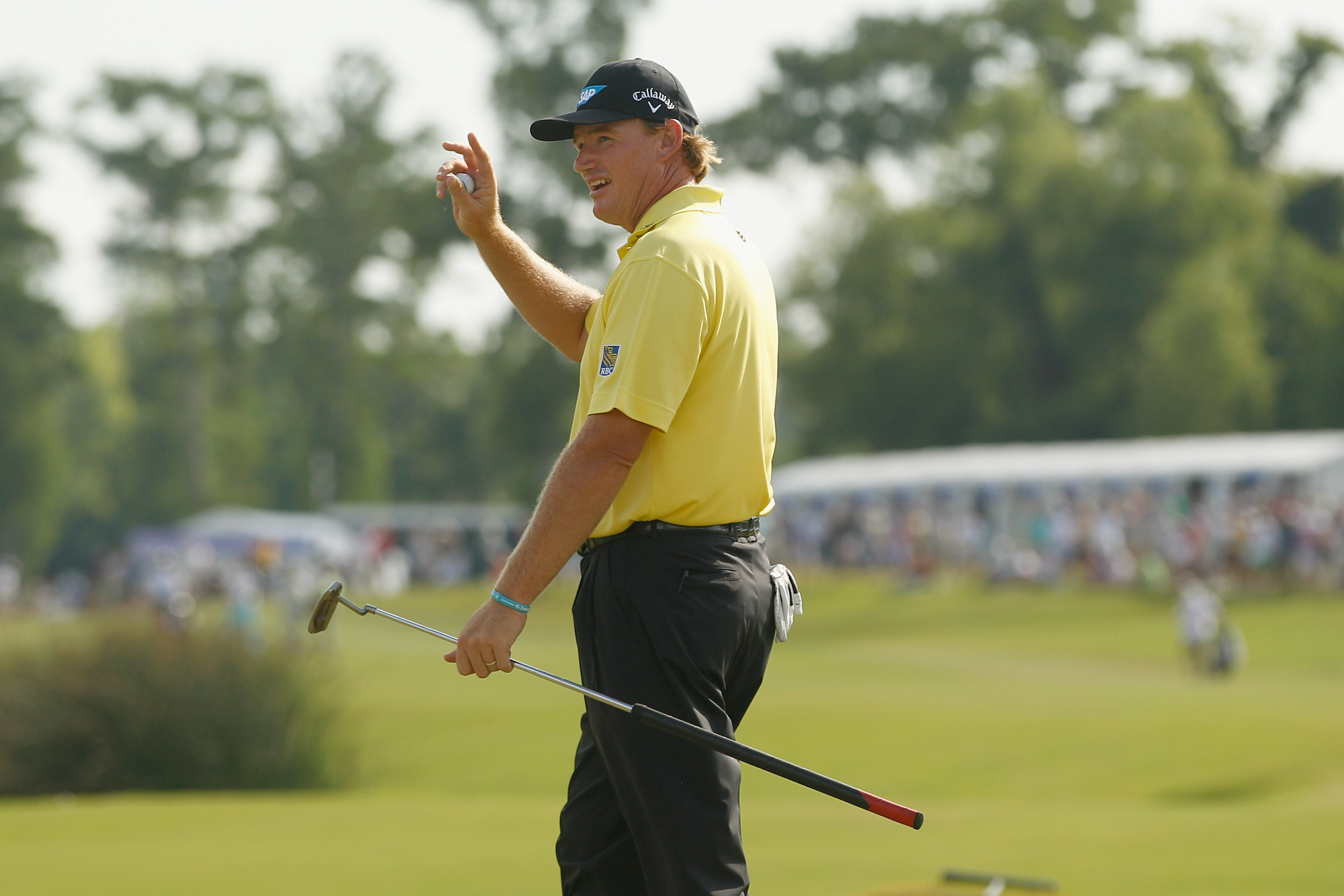 Ernie Els waves to the crowd after putting on No. 18 at the Zurich Classic. (Getty Images)