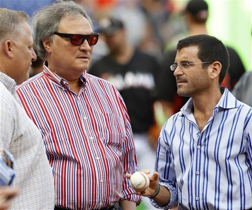 Miami owner Jeffrey Loria (center) has gutted the Marlins ... again. (AP)