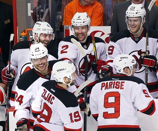 The Devils fought back with a four-goal third period to thwart the Flyers. (AP Photo)