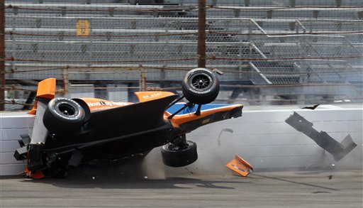 Charlie Kimball hits the first turn wall during a practice for the Indy 500. (AP)