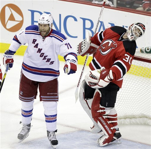 Tempers flared after the Rangers' Mike Rupp slugged Devils goalie Martin Brodeur in the mask. (AP)