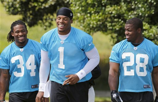 Panthers QB Cam Newton (1) says he wants to be a better teammate in his second season. (AP)