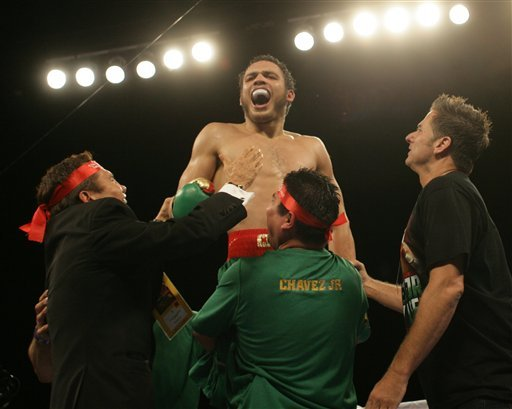 Julio Cesar Chavez, Jr., top, screamed in celebration after beating Andy Lee. (AP)