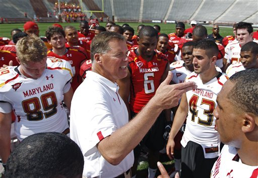 Randy Edsall, center, talks with his players after the team's annual spring scrimmage. (AP)