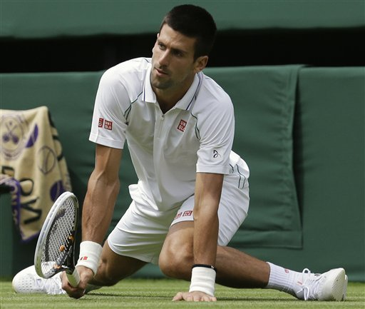 Golf club ready, Djokovic wins Wimbledon opener