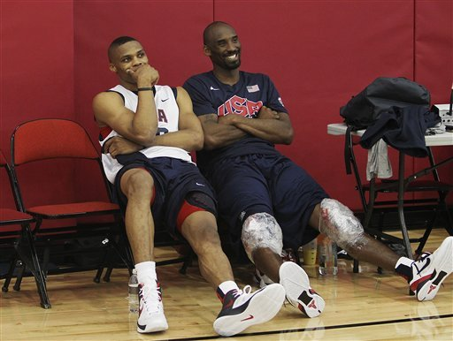 Kobe Bryant relaxes with Russell Westbrook, left, after Team USA's first Olympic practice. (AP)