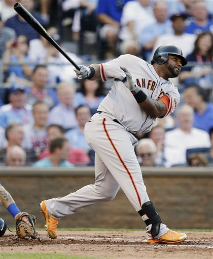 The Giants' Pablo Sandoval hit a three-run triple in the first inning for the NL. (AP)