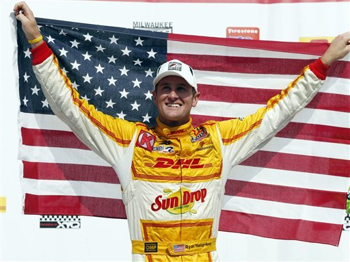 Hunter-Reay carrying the American flag in IndyCar