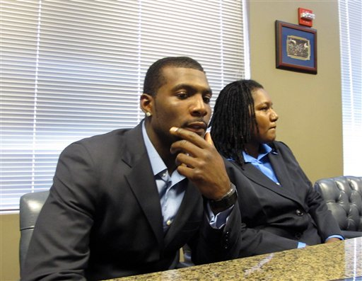 Dez Bryant sits next to his mother, Angela Bryant, a few days after his arrest. (AP)