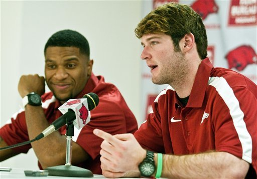 Knile Davis (left) and Tyler Wilson give Arkansas two stars in the backfield. (AP)