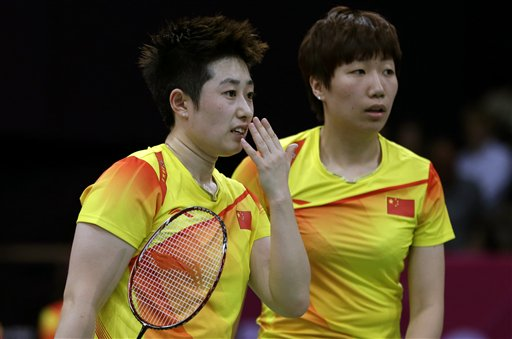 China's Yu Yang, left, retired from badminton after being kicked out of the Olympics. (AP)