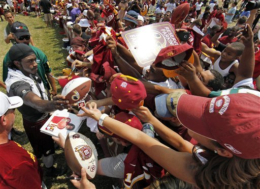Redskins fans certainly seem to be crazy about Robert Griffin III. (AP)