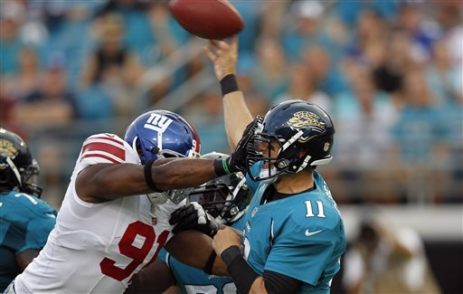 Blaine Gabbert is hit by Justin Tuck in last week's preseason game. (AP)