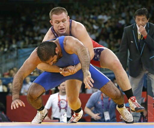 Wrestling has been a part of every modern Olympics dating back to 1896. (AP)
