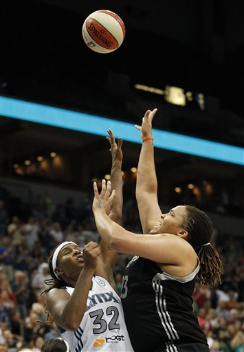 Whalen leads Minnesota to OT win over San Antonio