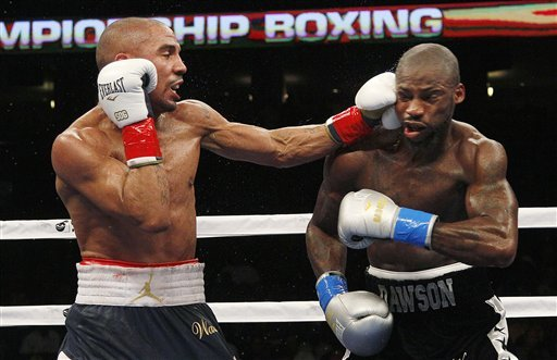 Andre Ward punches at Chad Dawson in the seventh round of their super middleweight title fight. (AP)