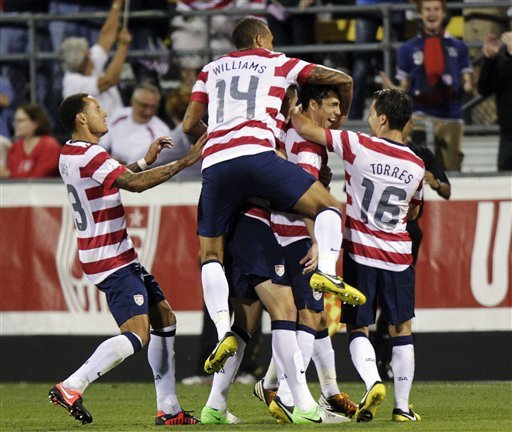 U.S. players celebrate Herculez Gomez's goal in the second half against Jamaica. (AP)