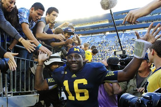 Denard Robinson played four years at Michigan. (AP)