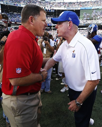 Greg Schiano and Tom Coughlin talk after the Giants' victory. (AP)