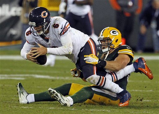 Jay Cutler is brought down by Packers OLB Clay Matthews in the Week 2 loss at Lambeau. (AP)