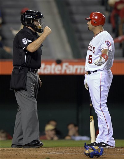 Albert Pujols argues after striking out in the fourth inning Thursday. (AP)