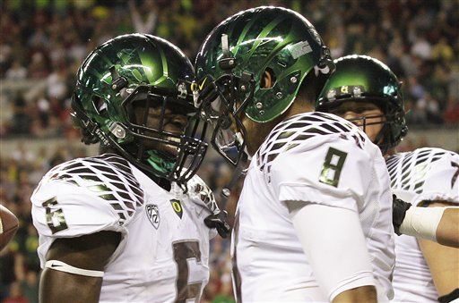 Kelly, Sark play down Oregon-Washington rivalry