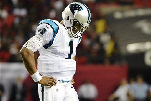 Cam Newton reacts after losing a fumble late vs. the Falcons. (AP)