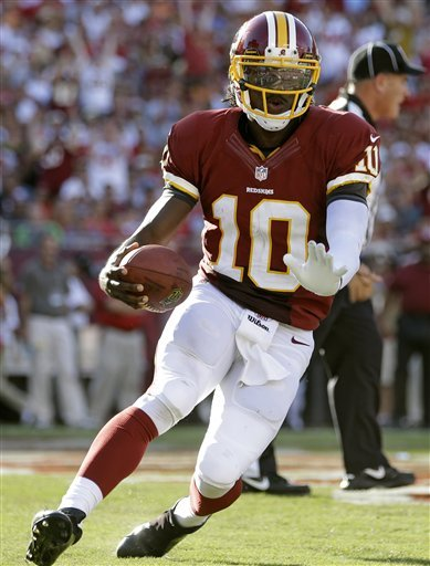Robert Griffin ran for a score and threw for more than 300 yards on Sunday against Tampa. (AP)