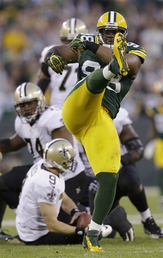 Packers' C.J. Wilson celebrates after sacking Drew Brees on Sunday. (AP)