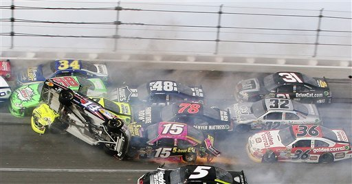 Tony Stewart (14) flips over a host of cars on the final lap at Talladega. (AP)