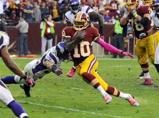 Robert Griffin III gets away from Vikings safety Harrison Smith during last Sunday's victory. (AP)