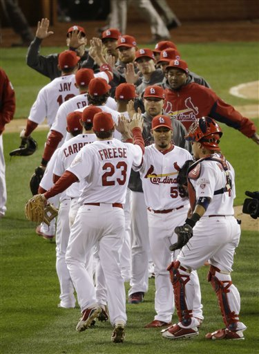 The Cardinals celebrate after winning Game 4 of the NLCS to take a 3-1 series lead. (AP)
