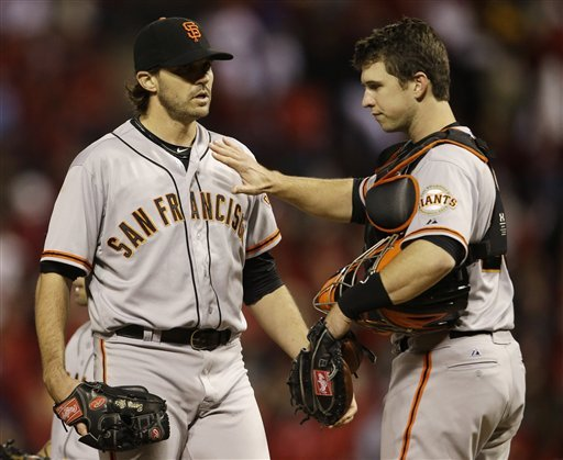 Buster Posey and Barry Zito have a conversation on the mound during the NLCS. (AP)