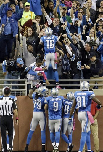 Titus Young (16) celebrates his second-quarter touchdown reception. (AP)