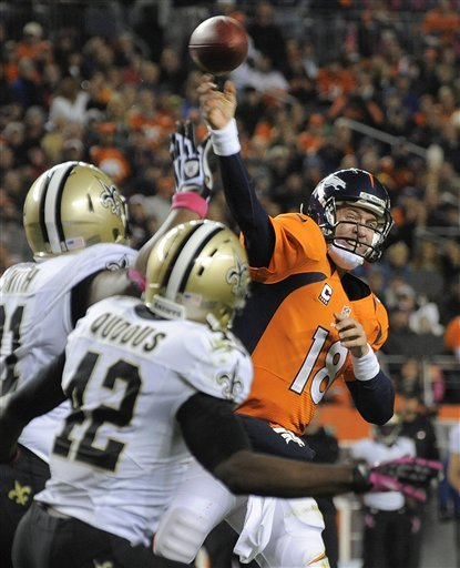 Peyton Manning throws a pass for a TD against the Saints in the third quarter. (AP)