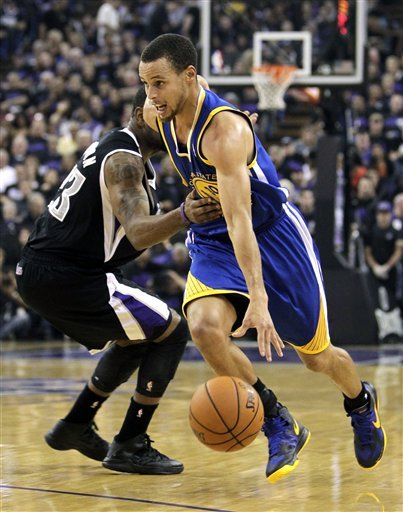 Kings hold off Warriors 94-92 for first win