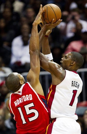 James hits clinching shot, Heat beat Hawks 95-89