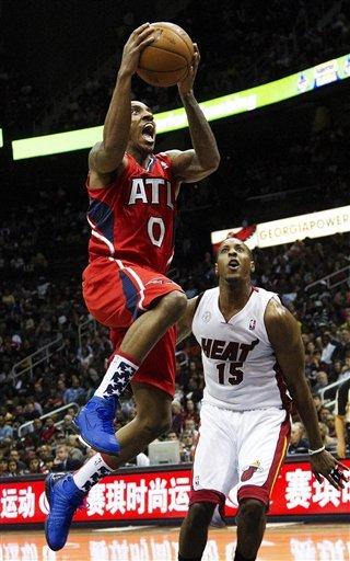 James hits clinching shot, Heat beat Hawks 95-89