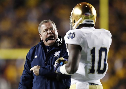 Brian Kelly talks with DaVaris Daniels during Notre Dame's win over Boston College. (AP)