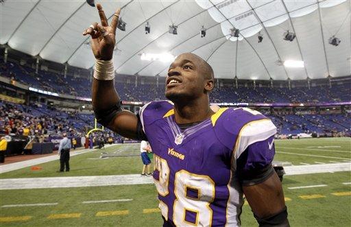 Peterson, Vikings run past Lions 34-24