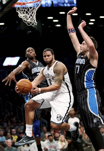 Nets hold on, finish home-and-home sweep of Magic