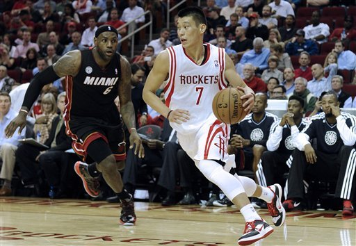 James scores 38 in Heat's 113-110 win at Houston