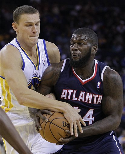 Barnes helps Warriors hold off Hawks, 92-88