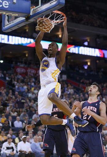 Barnes helps Warriors hold off Hawks, 92-88